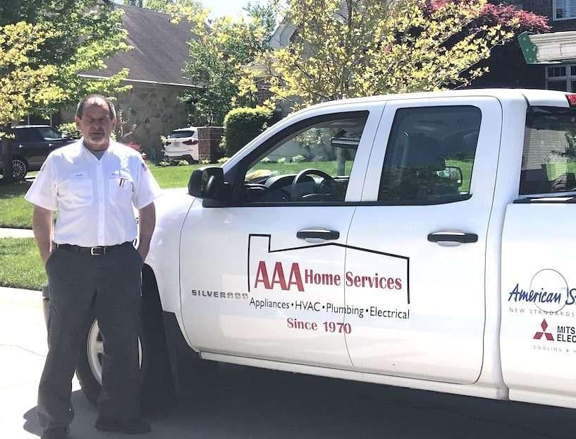 AAA in front of a home in St. Louis
